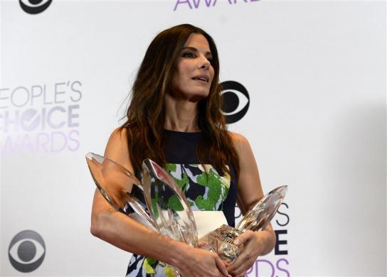 Sandra Bullock e seus 3 prêmios.